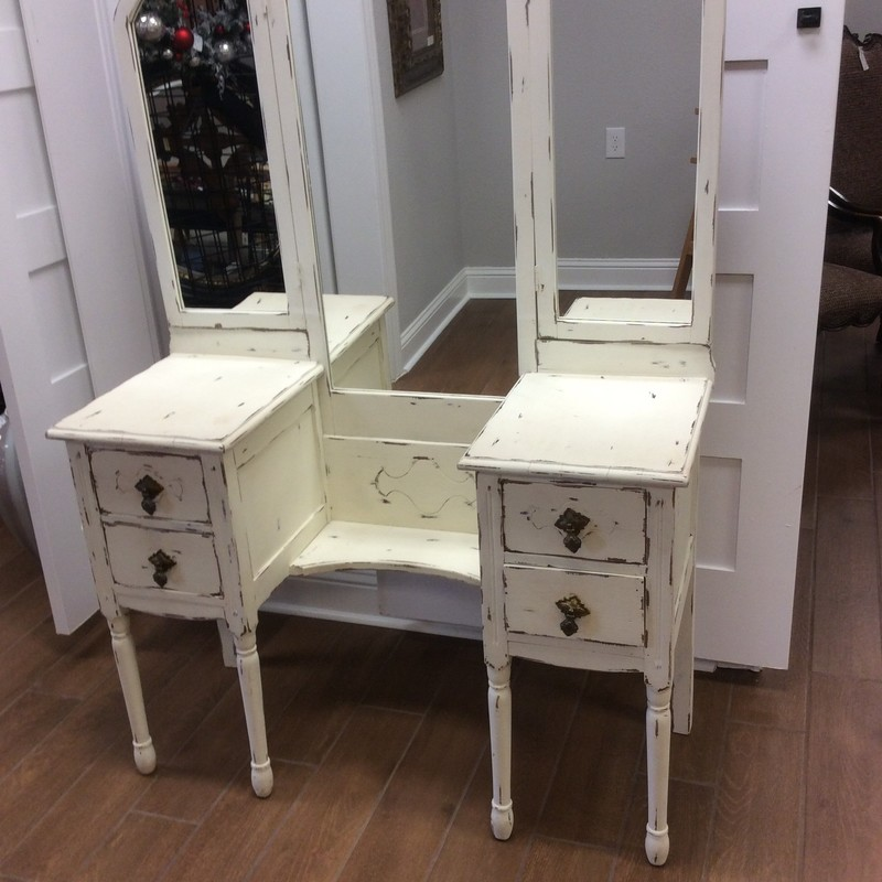 This Shabby Chic Vanity is sweeeet!!  Chalk painted a cream color with distressing to give it that weathered and timeworn appearance it features 4 spacious drawers and a 3-way mirror.
