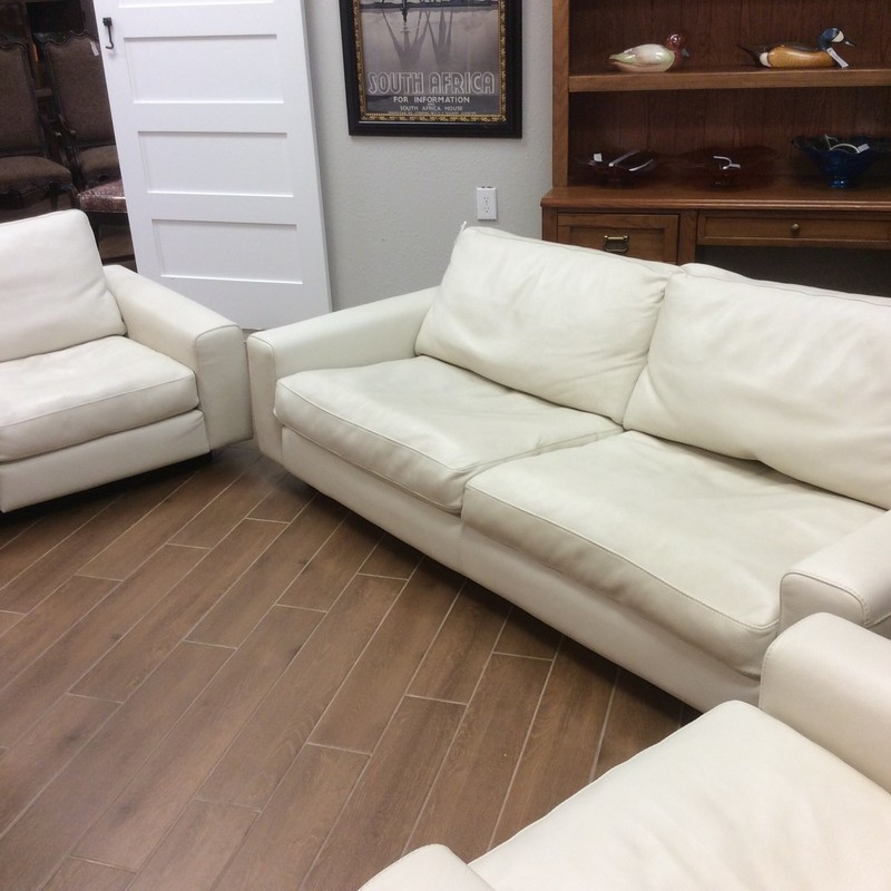 This living room set is stunning!! The set was imported from Italy and purchased in Bucharest, Romania. Obviously, it is super contemporary with clean, sleek lines. The leather is a creamy off-white and the padding on the inside is feather down.