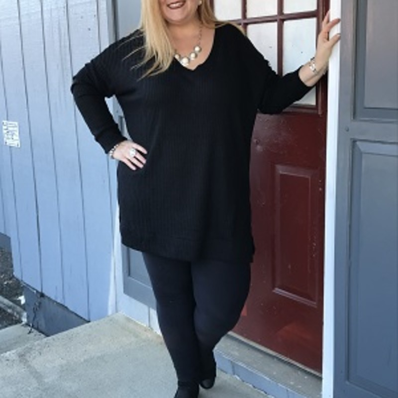 We are so excited about our Zenana Waffle V-neck Tunic, it is absolutely gorgeous. You can wear this to any occasion. The material is made of 59% Polyester 38% Rayon 3% Spandex with a length of 32in.