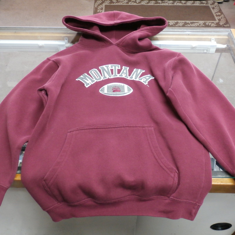 "Montana Grizzlies YOUTH Hooded Sweatshirt Size Small Polyester #27020<br /> Rating: (see below) 3 - Good Condition<br /> Team: Montana Grizzlies<br /> Player: N/A<br /> Brand: Missing Tag<br /> Size: Small - (Measured Flat: chest 17"", length 23"")<br /> Measured laying flat: armpit to armpit; top of shoulder to bottom hem<br /> Color: Maroon<br /> Style: Embroidered logo; hooded sweatshirt; Personalized name ""MARSH""<br /> Material: 70% Cotton 30% Polyester<br /> Condition: 3 - Good Condition: missing logo tag; stain on the back of the left sleeve; fuzzy; normal signs of use<br /> Item #: 27020<br /> Shipping: FREE"