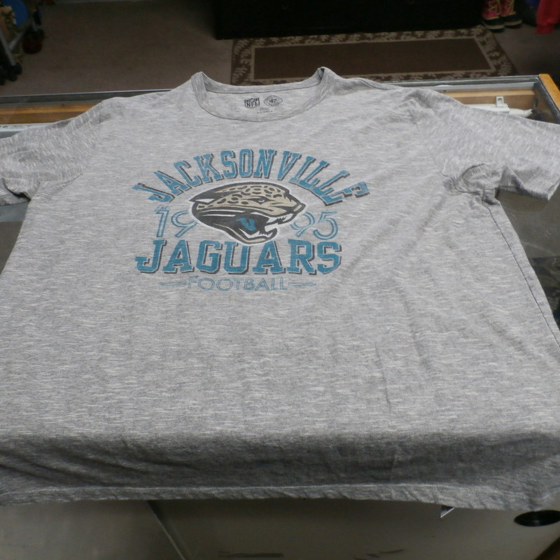 "Jacksonville Jaguars Men's shirt gray size XL Cotton Blend #16981<br /> Rating: (see below) 3 - Good Condition<br /> Team: Jacksonville Jaguars<br /> Player: N/A<br /> Brand: Forty Seven Brand<br /> Size: XLMen's - (Measured Flat: chest 23"", length 28"")<br /> Measured laying flat: armpit to armpit; top of shoulder to bottom hem<br /> Color: Gray<br /> Style: Short sleeve screen pressed shirt<br /> Material: 75% Cotton  25% polyester<br /> Condition: 3 - Good Condition: slight fading and discoloration; pilling and fuzz; material is stretched and worn a little; logo is faded out<br /> Item #: 16981<br /> Shipping: FREE"