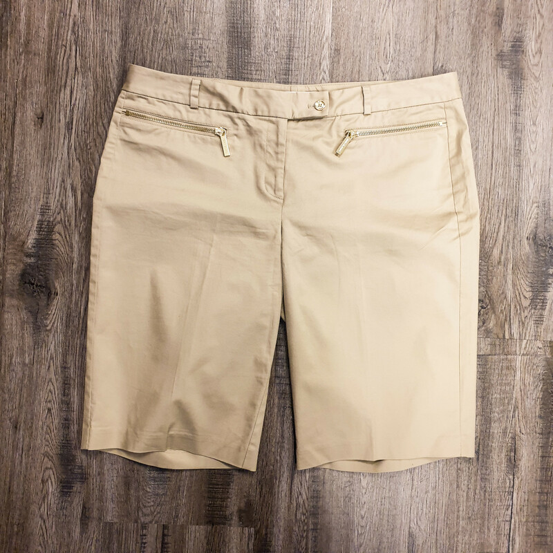 Beautiful Michael Kors Shorts.<br /> - Tan color<br /> - Real front pockets<br /> - Waist circumference: 38 in.<br /> - Length: 21 in.<br /> - Size Large/14<br /> <br /> * Please note that these measurements and pictures are for reference only and may vary slightly from the original.