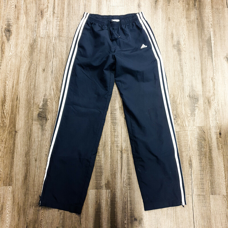 Beautiful Adidas Pants.<br /> - Navy and white color<br /> - Side stripes<br /> - Side pockets<br /> - Bottom zipper<br /> - Stretchy waistband<br /> - Waist circumference: 26 in.<br /> - Length: 38.5 in.<br /> - Size Small<br /> <br /> * Please note that these measurements and pictures are for reference only and may vary slightly from the original.