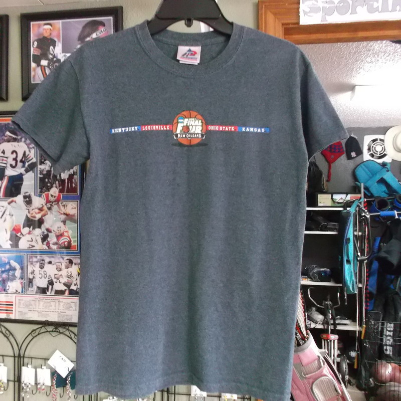 "NCAA 2012 Final Four New Orleans Adult Short Sleeve Shirt Size Small Gray #7883<br /> Rating:   (see below) 4 - Fair Condition<br /> Team: Kentucky Wildcats; Louisville Cardinals; Ohio State Buckeyes; Kansas Jayhawks<br /> Player: n/a <br /> Brand: Tri-Lake Inc. Sportswear<br /> Size: Small Adult (MEASURED FLAT - chest 17""; length 26"") armpit to armpit and top of shoulder to bottom hem<br /> Color:  Gray<br /> Style: Screen pressed short sleeve shirt<br /> Material: Cotton/Polyester Blend<br /> Condition: - Fair Condition - wrinkled; Significant pilling and fuzz; Material feels coarse; Material is faded and discolored; Logos are cracked; Signs of definite use; Small holes center of the front(See Photos for condition and description)<br /> Shipping: $3.37<br /> Item#: 7883"