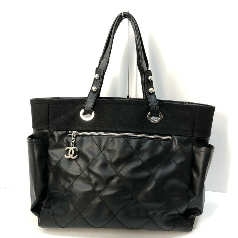 Chanel Large Paris-Biarritz tote with silver-tone hardware, dual flat shoulder straps, three exterior pockets; one with zip closure, protective feet at base, tonal woven lining, three pockets at interior walls; one with zip closure and zip closure at top. Includes Autheticity Card.