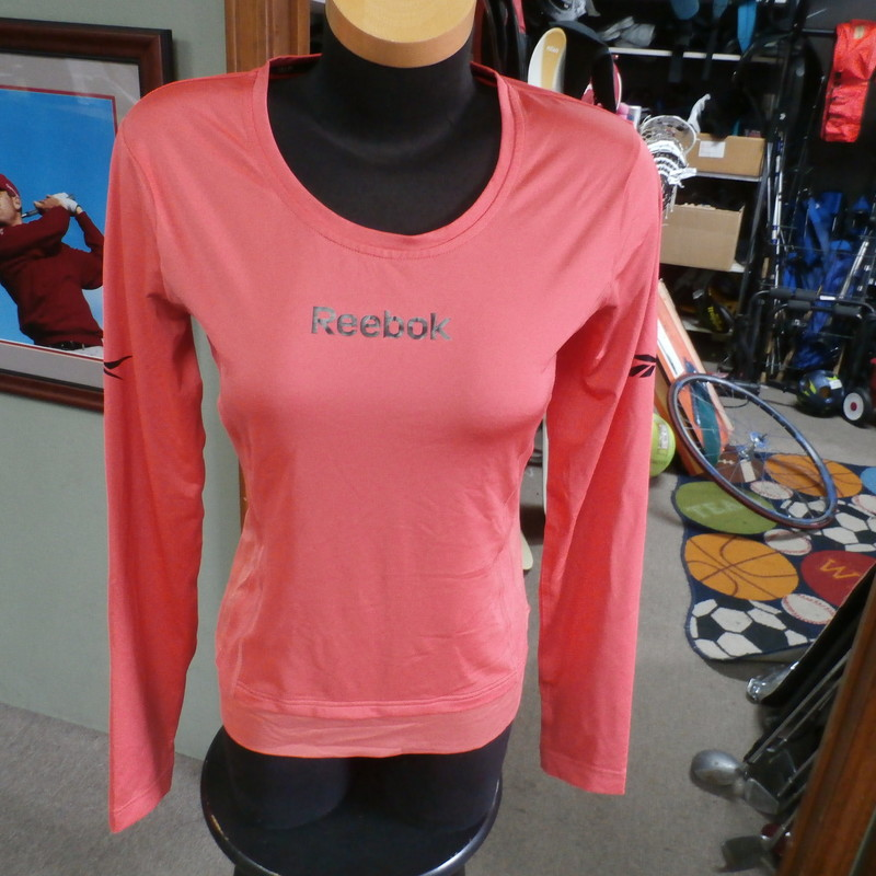 "Reebok pink Play Dry long sleeve athletic shirt size Medium polyblend #27463<br /> Rating: (see below) 3- Good Condition<br /> Team: n/a<br /> Player: n/a<br /> Brand: Reebok<br /> Size: Women's Medium- (Measured Flat: chest 18"", length 25"")<br /> Color: pink<br /> Style: long sleeve; screen printed<br /> Material: 88% polyester 12% spandex<br /> Condition: 3- Good Condition: minor wear; sweat stains in armpits (see photos)<br /> Item #: 27463<br /> Shipping: FREE"