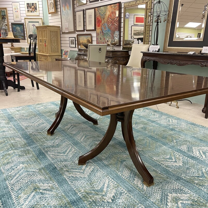 Mahogany Dining Room Table, plus +2 Leaves. Stunning condition, gorgeous! Includes two 22in leaves and table pads. Table does not include chairs.<br /> Size: 87L x 46W x 30H<br /> <br /> With leaves inserted, the table expands to a magnificent  11 feet long!<br /> <br /> This item is not eligible for shipping - local pickup only.