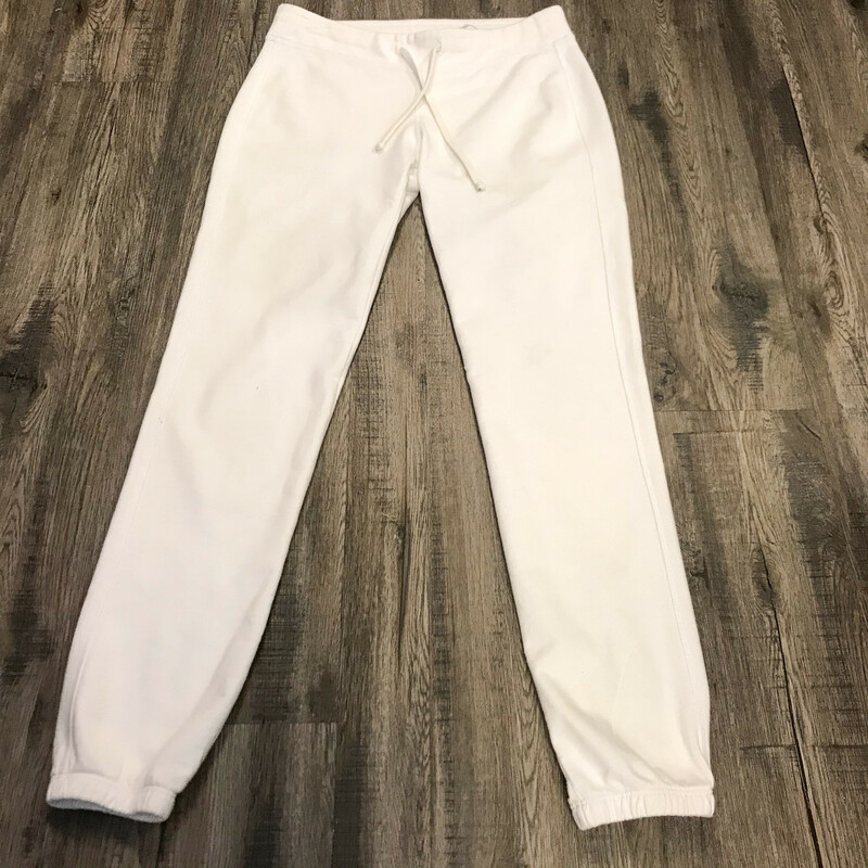 Sporty James Perse Pants.<br /> - White color<br /> - Drawstring waistband<br /> - Two back pockets<br /> - Stretchy<br /> - Waist circumference: 30 in.<br /> - Length: 37.5 in.<br /> - Size XSmall<br /> <br /> * Please note that these measurements and pictures are for reference only and may vary slightly from the original.