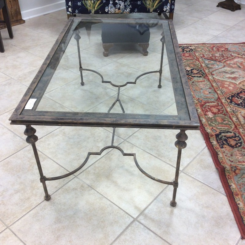 "The understated elegance of this coffe table is it's greatest selling point. The iron has been ""antiqued"" with gold and black. Lovely!"