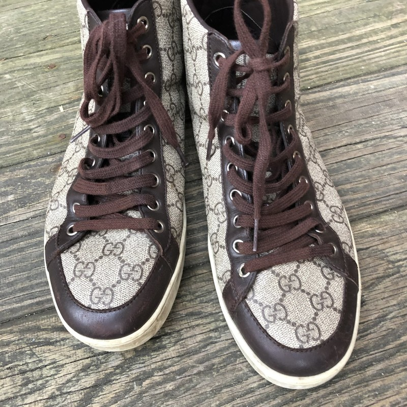 Gucci hightops, shows wear on sole. Good condition!