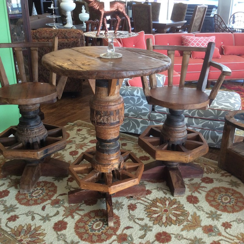 "Now, isn't this a rustic yet handsome trio! The table is only 32"" around, but stands 43"" tall. The 2 arm chairs have footrests, and they swivel too! We also have another almost identical set, that is available for purchase seperately."