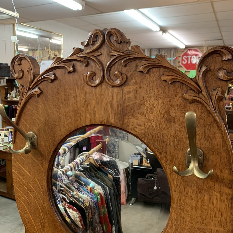 "Antique Hall Tree - In excellent condition! Stands 6'3' High, 2' Wide and 15"" deep. Made of gorgeous mission Tiger Oak and feature exceptional hand-carved filigree atop the round leaded mirror."