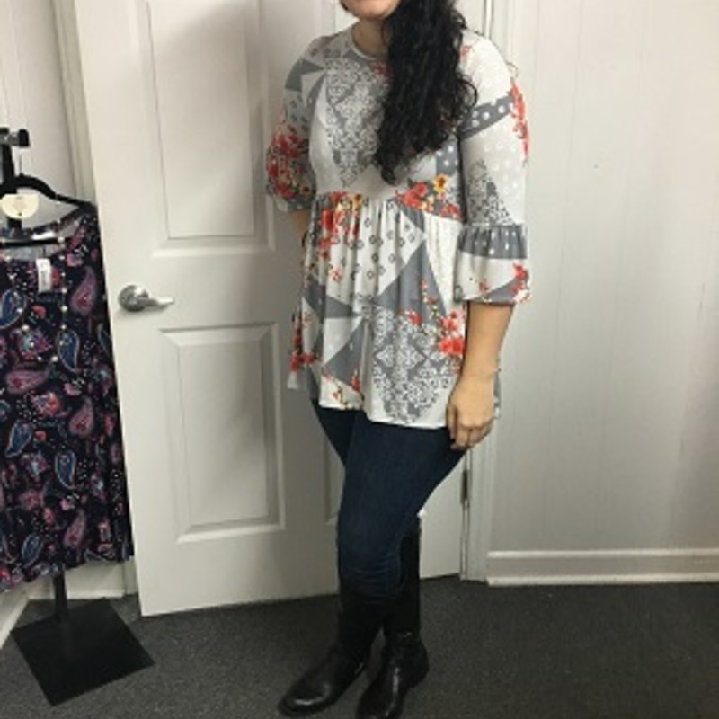 Our new arrived Ruffle Sleeve Floral Tunic is absolutely gorgeous. You can wear this with a pair of leggings and boots for any occasion. The material is made of 92% Polyester 8% Spandex with a length of 36in.
