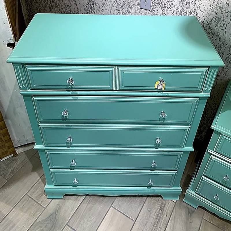 Jade 2pc Dresser Set<br /> This is a beautifully refinished dresser set. The set includes two dresser that have both been painted a jade green. They have also been distressed and accented with clear crystal knobs. Tall dresser measures 36&quot; wide x 18&quot; deep x 47&quot; tall. Long Dresser measures 50&quot; long x 18&quot; deep x 31&quot; tall. Buzz on in to see them today!