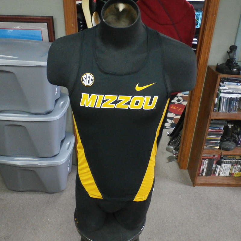 "Missouri Tigers black Nike Dri-Fit tank size small polyester #27833<br /> Rating: (see below) 3- Good Condition<br /> Team: Missouri Tigers<br /> Player: n/a<br /> Brand: Nike<br /> Size: Men's Small- (Measured Flat: Across chest 18""; Length 25"")<br /> Measured Flat: underarm to underarm; top of shoulder to bottom hem<br /> Color: black<br /> Style: sleeveless; screen printed<br /> Material: 100% polyester<br /> Condition: 3- Good Condition - minor wear; sharpie marks on tags (see photos)<br /> Item #: 27833<br /> Shipping: FREE"