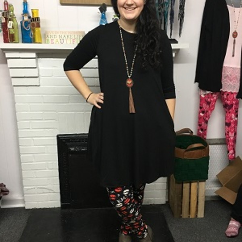 Merie looks stunning in our new Black Zenana 3/4 Sleeve Pocke Dress! It is super cute and perfect for now and spring season. The material is made of 55% Polyester 40% Rayon 5% Spandex with a length of<br /> 38in.
