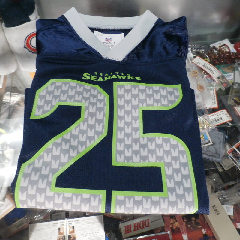"Seattle Seahawks Toddler #25 Sherman Jersey blue size 3T 100% polyester #27999<br /> Rating: (see below) 2- Great Condition<br /> Team: Seattle Seahawks<br /> Player: Richard Sherman<br /> Brand: NFL Team Apparel<br /> Size: Toddler 3T- (Measured Flat: Across chest 11""; Length 15"")<br /> Measured Flat: underarm to underarm; top of shoulder to bottom hem<br /> Color: blue<br /> Style: short sleeve; screen printed emblem and logos; jersey<br /> Material: 100% polyester<br /> Condition: 2- Great Condition: wrinkled; minor pilling and fuzz; clean and crisp; some of the letters are starting to come off<br /> Item #: 27999<br /> Shipping: FREE"