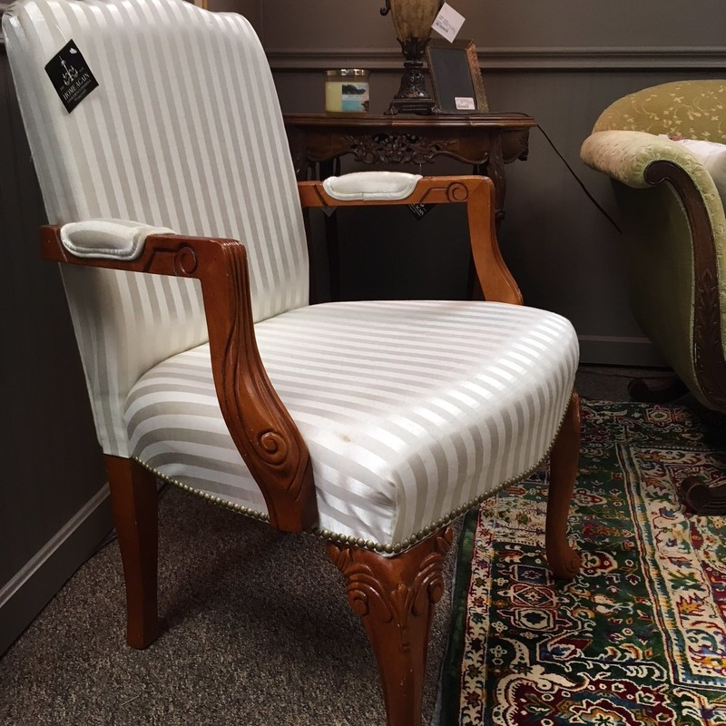 Sturdy and beautiful arm chair.  The fabric is striped two-toned cream.