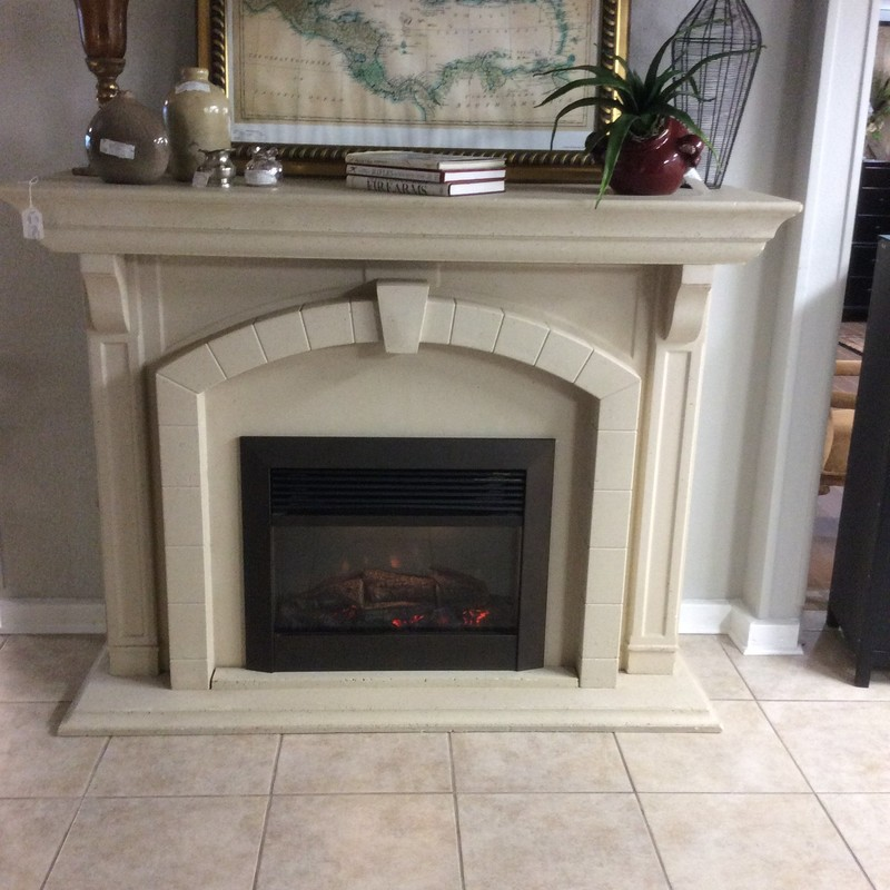 Now this is a piece of furniture that is both beautiful and practical. The free-standing mantle is constructed in a creamy colored, travertine-looking composite. The electric fireplace insert provides both asthetic appeal and additional WARMTH! Stop by and check it out.