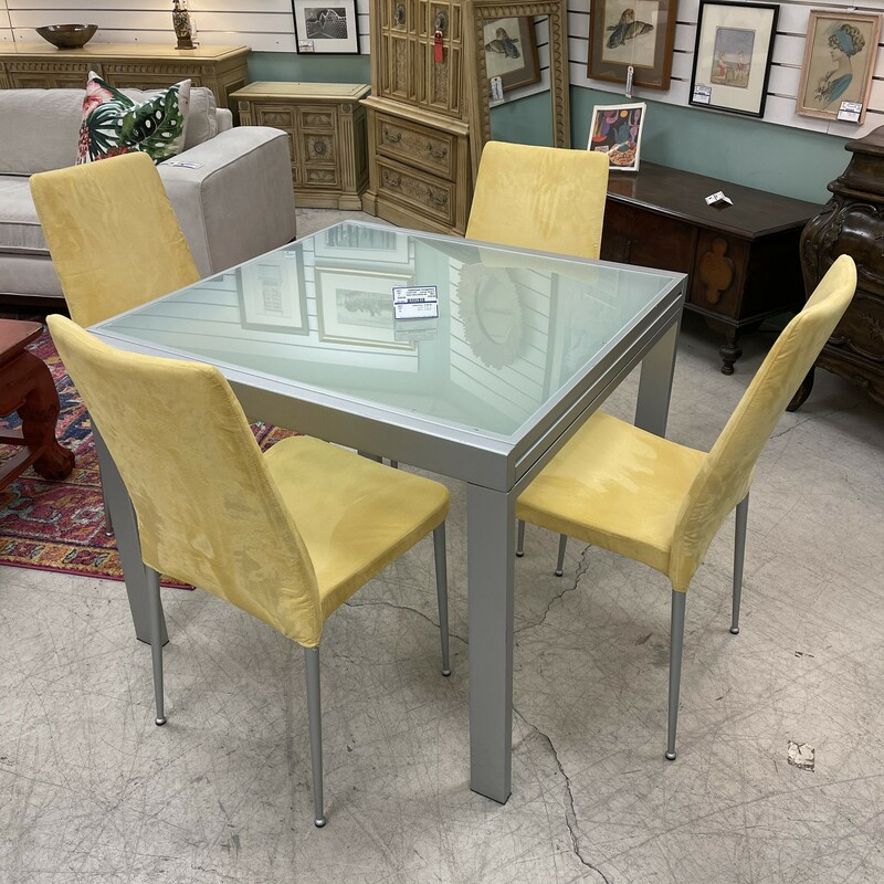 Italian Glass Dinette Set, with extending glass leaf. Made in Italy. Includes 4 yellow dining chairs.<br /> Size: 36insq<br /> <br /> This item is not eligible for shipping - local pickup only.
