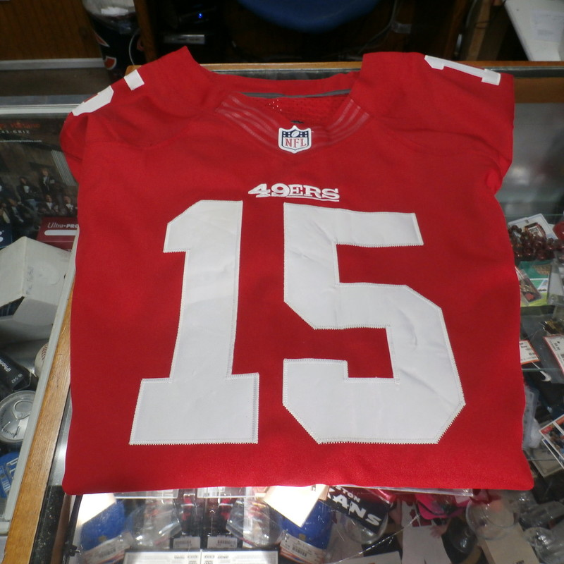 "SF 49ers Michael Crabtree Football Jersey Red Size 52 100% polyester #27708<br /> Rating: (see below) 4- Fair Condition<br /> Team: SF 49ers<br /> Player: Michael Crabtree #15<br /> Brand: Nike<br /> Size: Men's 52- (Measured Flat: Across chest 23""; Length 31"")<br /> Measured Flat: underarm to underarm; top of shoulder to bottom hem<br /> Color: Red<br /> Style: Football jersey; embroidered<br /> Material: 100% polyester<br /> Condition: 4- Fair Condition: wrinkled; noticeable wrinkles and marks on the numbers front and back; snags in a few places; loose strings on the seams; tag is worn out; black marks on the R sleeve;<br /> Item #: 27708<br /> Shipping: FREE"