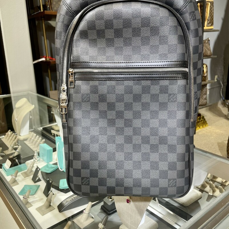 The Michael backpack is a sleek, modern design in Damier Graphite canvas with black leather trim. Geared to active lifestyles, it can be carried in the hand or on the shoulder. Its main compartment features a secure and convenient double zip closure and a padded pocket to hold a laptop.<br /> Detailed Features<br /> 11 x 17.7 x 7.1 inches<br /> (length x Height x Width)<br /> Black<br /> Damier Graphite coated canvas<br /> Cowhide-leather trim<br /> Textile lining<br /> Silver-color hardware<br /> Adjustable shoulder straps<br /> Double zip closure<br /> 2 outside zipped pockets<br /> Foam-padded computer pocket<br /> Mobile phone pocket<br /> Handle:Single<br /> This reference is either Made in France, Spain, Italy or in the US.