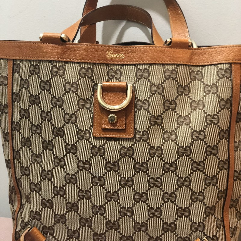 This Gucci tote is in very good preowned condition!<br /> Measures 12&quot; w by 10&quot; tall and is 4&quot; deep. strap drop is 6&quot;. Gorgeous light brown leather trim and GG monogramed canvas. Shiny gold hardware.<br /> This is a gorgeous Gucci for this price!