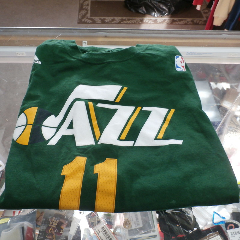 "Adidas Men's Green Utah Jazz Shirt Size Large  #11 Watson 100% Cotton #27425<br /> Rating:   (see below) 2- Great Condition<br /> Team: Utah Jazz<br /> Player: Watson #11<br /> Brand: Adidas<br /> Size: large;  - Men's (Measured Flat: Across chest 21"", length 27"")<br /> Measured Flat: arm pit to arm pit; top of shoulder to the hem<br /> Color: Green<br /> Style: Screen pressed T-Shirt<br /> Material:  100% Cotton<br /> Condition: - 2 Great Condition - Wrinkled; Small white stain on back bottom of shirt; also small one on front both likely to come out when washed; its like new other then that<br /> Item #: 27425<br /> Shipping: FREE"