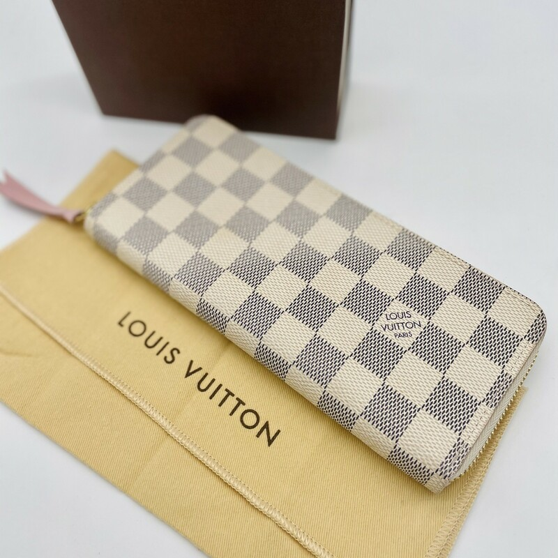 The slim-line Clémence wallet is crafted from Damier Azur canvas with a grained-leather lining. Its all-round zip opens wide to allow easy access to its two generous compartments, complete with pockets and card slots. Refined details, such as the leather zip pull, mean the Clémence can also be used as a clutch.<br /> Detailed Features<br /> 7.87 x 3.54 x 0.79 inches<br /> (length x Height x Width)<br /> Rose Ballerine Pink<br /> Damier Azur coated canvas<br /> Grained cowhide-leather trim<br /> Grained cowhide-leather lining<br /> Gold-color hardware<br /> Zip closure<br /> 2 large gusseted compartments<br /> Zipped coin pocket<br /> 2 inside flat pockets<br /> 8 card slots<br /> The reference is either made in France, Spain, Italy or in the US.