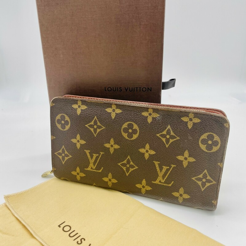 This wallet is crafted of signature Louis Vuitton monogram on toile canvas. This wallet features a brass wrap-around zipper that opens to a terra cotta cross-grain leather interior with card slots, a zipper compartment, and patch pockets. This is a chic wallet to organize all of your everyday needs, by Louis Vuitton!<br /> <br /> Base Length: 6.25 in<br /> Height: 3.75 in<br /> Width: 0.75 in