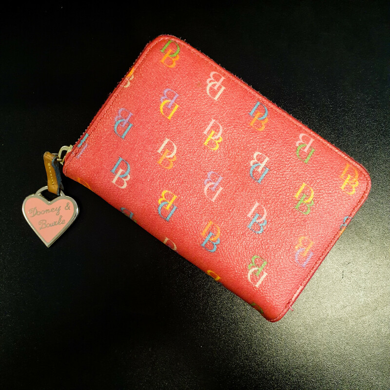 "Beautiful Dooney&Bourke Wallet.<br /> - Pink color<br /> - Rainbow ""DB\"" print<br /> - Rainbow zip-top closure<br /> - Interior features: one zip pocket with two compartments and two card slips, Plus eigth card slips<br /> - W: 6 in. H: 4 in. D: 1 in.<br /> <br /> * Please note that these measurements and pictures are for reference only and may vary slightly from the original."