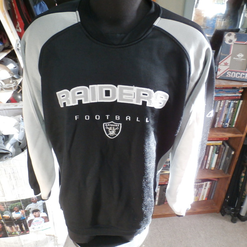 Oakland Raiders Reebok sweater black size Large polyester blend #28431<br /> Rating: (see below) 3- Good Condition<br /> Team: Oakland Raiders<br /> Player: n/a<br /> Brand: Reebok<br /> Size: Men&#039;s Large- (Measured Flat: Across chest 26&quot;; Length 30&quot;)<br /> Measured Flat: underarm to underarm; top of shoulder to bottom hem<br /> Color: black<br /> Style: long sleeve; embroidered<br /> Material: 80% polyester  20% cotton<br /> Condition: 3- Good Condition: minor wear; some loose threads on front embroidery and some of the white parts are coming loose (see photos)<br /> Item #: 28431<br /> Shipping: FREE