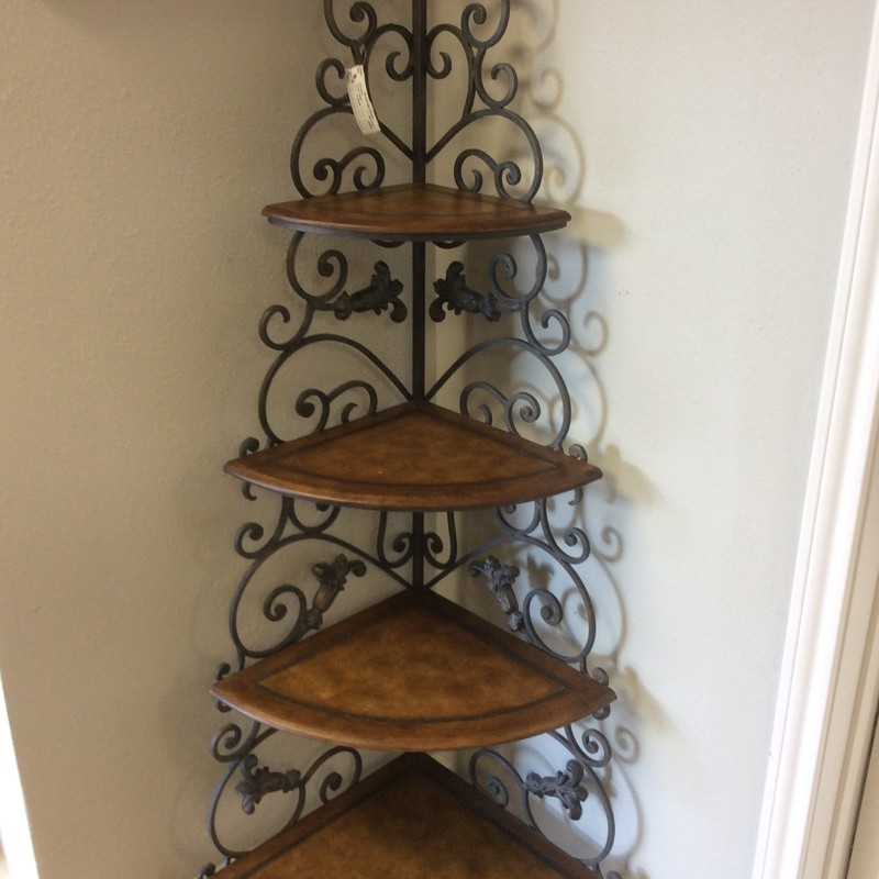 This is a very smart looking corner shelf unit!  It features 4 shelves and attractive metal scrollwork. It is quite heavy and, therefore, very sturdy.