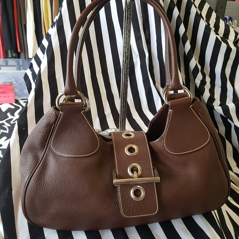 Beautiful Prada Brown leather tote with silver hardware and large front buckle. Perfect condition! No duster.