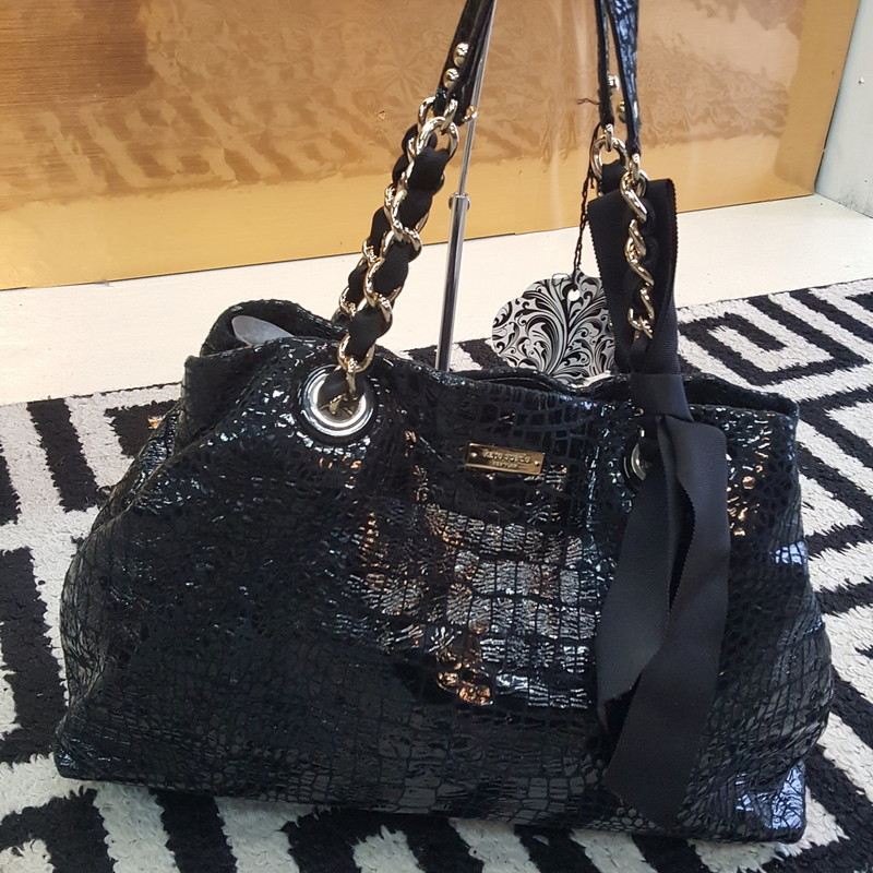 GORGEOUS black Kate Spade. Has chain and leather handle. Like new, no signs of use. Gold hardware. Does not include duster bag.