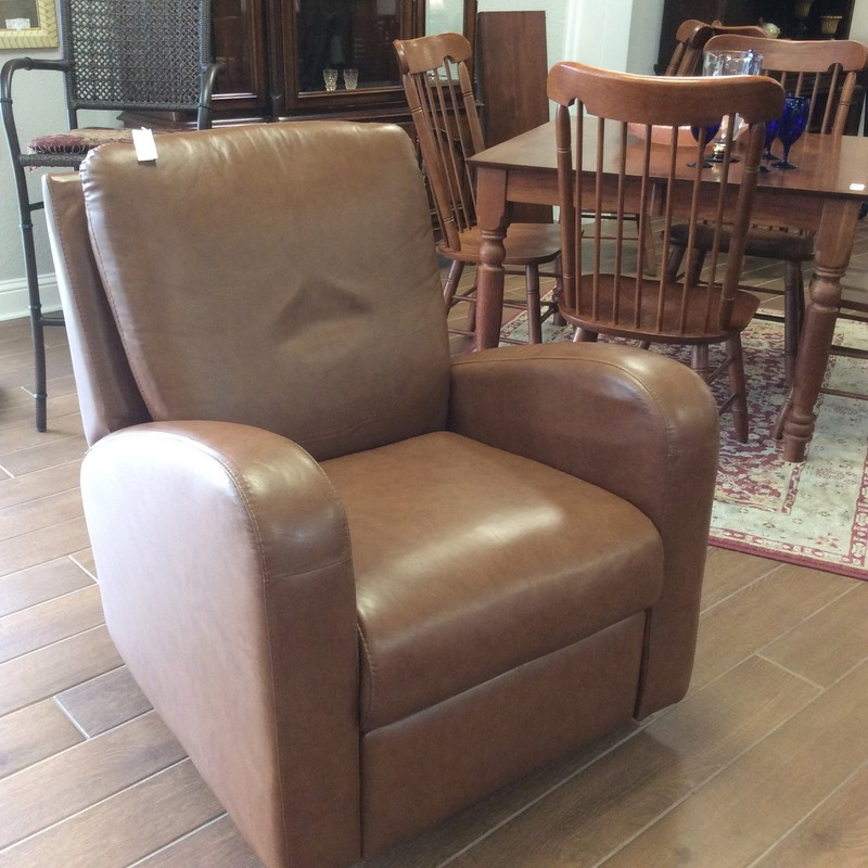 Gorgeous! This rocker/recliner is all leather in a sumptious chestnut. It is simple, elegant and in perfect condition.