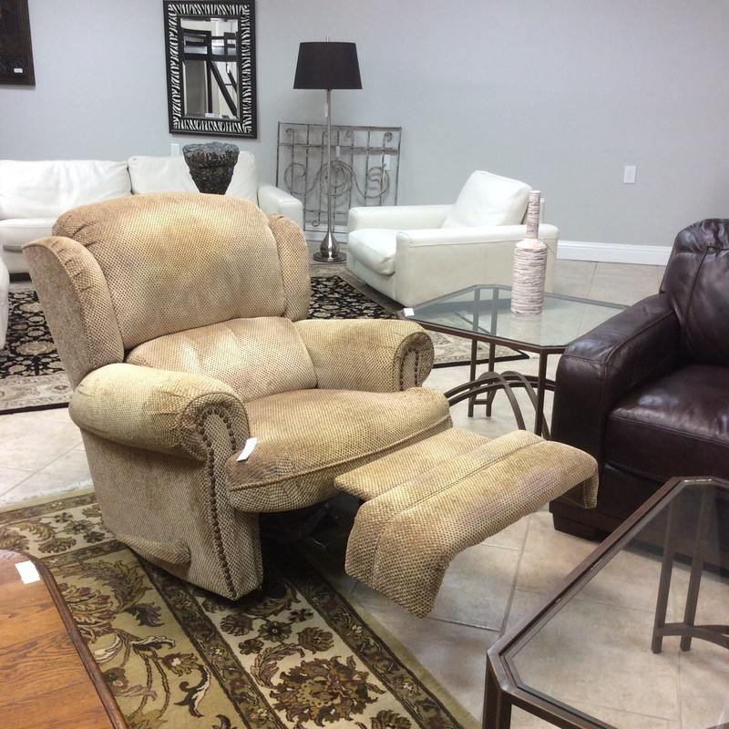 This rocker recliner has been priced to sell!  Large in size, it has been upholstered  in gold with hints of red and green. It has seen some wear but it's super comfy and best of all, we have two of them. Come in soon and take a look!