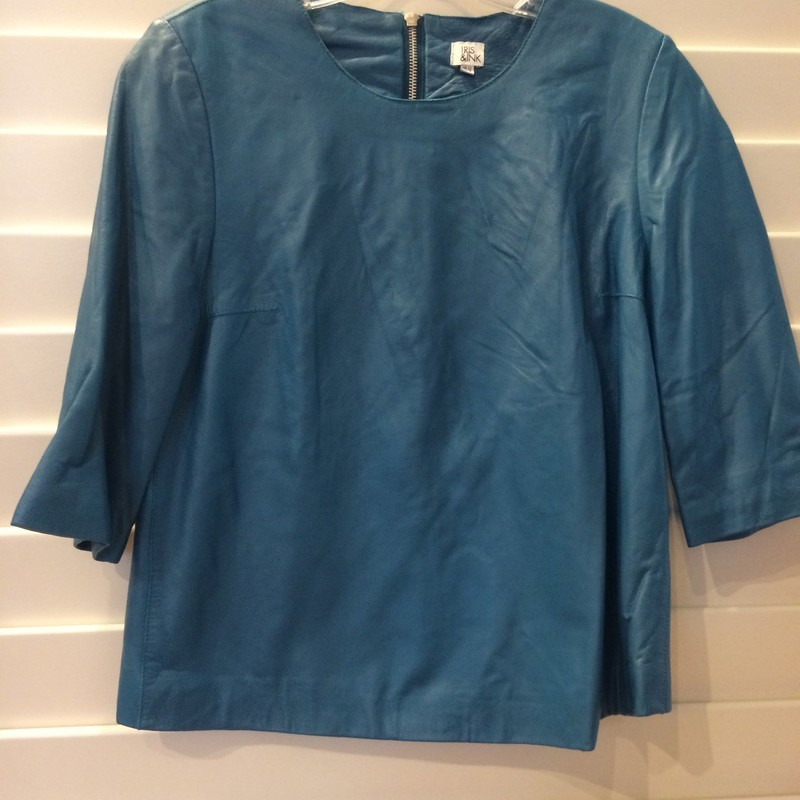 This top is stunning, in an unusual blue-ish, teal color. It's made from 100% lamb leather. There is some tearing along the seam of the inner lining (see pictures). Size 8.