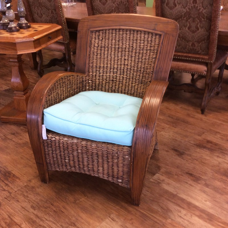 This rattan chair is really nice! It's from Pier 1, large and comfy with a summery breeze aqua cushion.