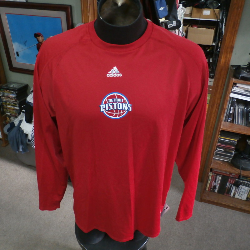 "Detroit Pistons red Adidas nbafusion long sleeve shirt size tag missing #28847<br /> Rating: (see below) 3- Good Condition<br /> Team: Detroit Pistons<br /> Player: Aron Bynes<br /> Brand: Adidas nbafusion<br /> Size: Size tag missing estimated XL- (Measured Flat: Across chest 25""; Length 29"")<br /> Measured Flat: underarm to underarm; top of shoulder to bottom hem<br /> Color: red<br /> Style: long sleeve; screen printed<br /> Material: 100% polyester<br /> Condition: 3- Good Condition: minor wear; ""12"" written in marker on Adidas logo on front; very tiny holes on left shoulder (see photos)<br /> Item #: 28847<br /> Shipping: FREE"