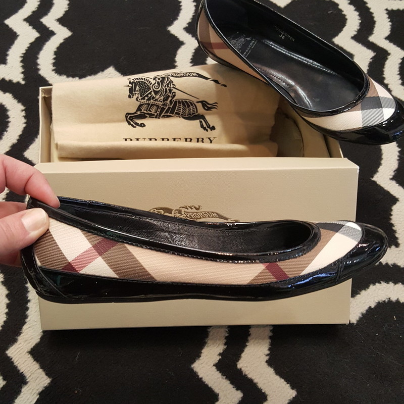 GENTLY USED, Burberry flats, black pantent leather with tan, red, and black plaid details, with box, size 6. Retail: $325.00