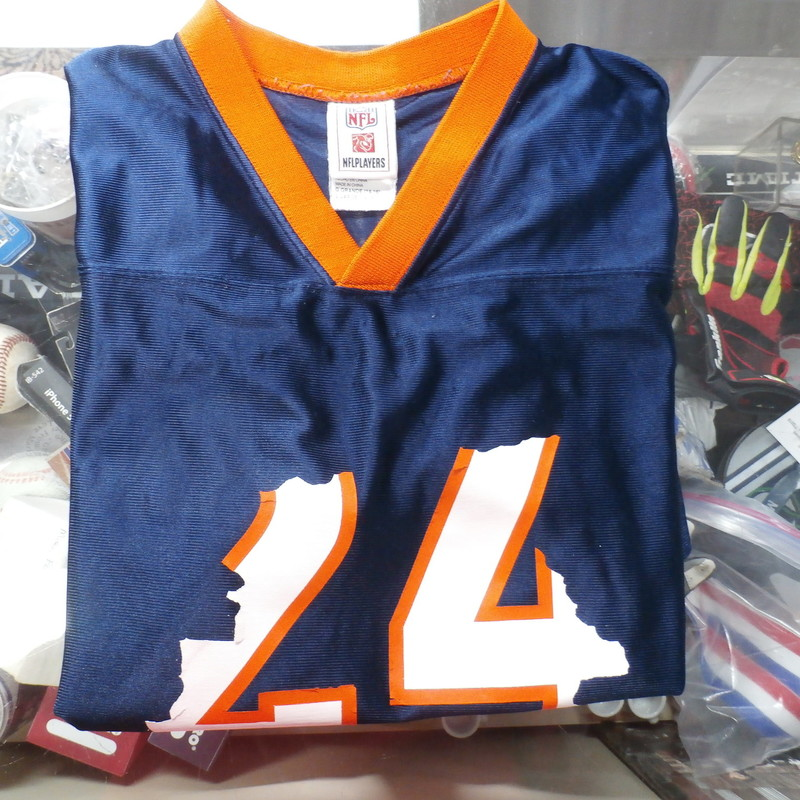 "NFL Youth Denver Broncos Champ Bailey Jersey Size Large Blue Polyester #25542<br /> Rating: (see below) 4- Fair Condition<br /> Team: Denver Broncos<br /> Player: Champ Bailey<br /> Brand: NFL<br /> Size: Youth  L (Measured Flat: Chest 18""; Length 25"";)<br /> Measured flat: across waist laying flat; waist to bottom of legs; crotch to bottom of legs<br /> Color: Blue<br /> Style: NFL Jersey Screen pressed<br /> Material:  100% Polyester<br /> Condition: 4- Fair Condition:  wrinkled; pilling and fuzz; few snags; the numbers 24 on the front are almost all worn off; everywhere where there is something screen pressed its starting to wear off throughout the jersey; still reads Bailey and # 24 on back though<br /> Item #: 25542<br /> Shipping: FREE"