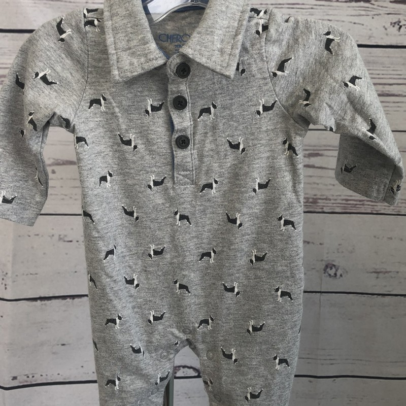 Cherokee long sleeve. This one piece outfit has puppies printed on it. There are snaps in the bottom for easy diaper changing.