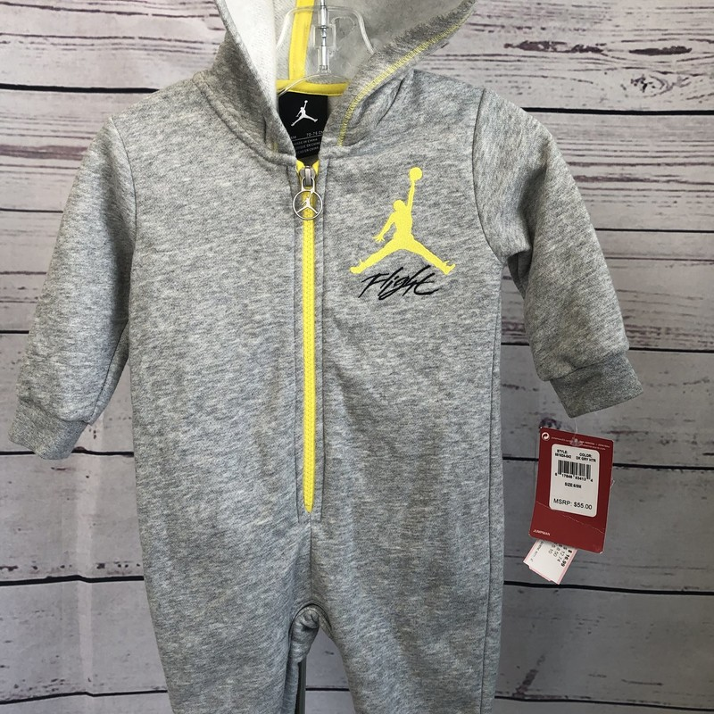 NEW with Tags adorable Jordan outfit. This has snaps in the bottom to make diaper changing easier.  Your little one would look cute in the outfit!