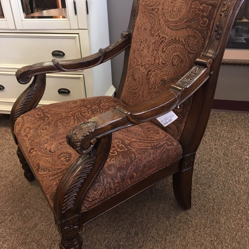 Beautiful brown arm chair with solid wood arms and legs.