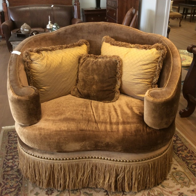 I guess the name of this chair says it all! It's fit for a princess, to be sure. 2 people can easily cozy up together in this chair. There is also a matching ottoman, that is available for purchase seperately. Stop by and check it out!
