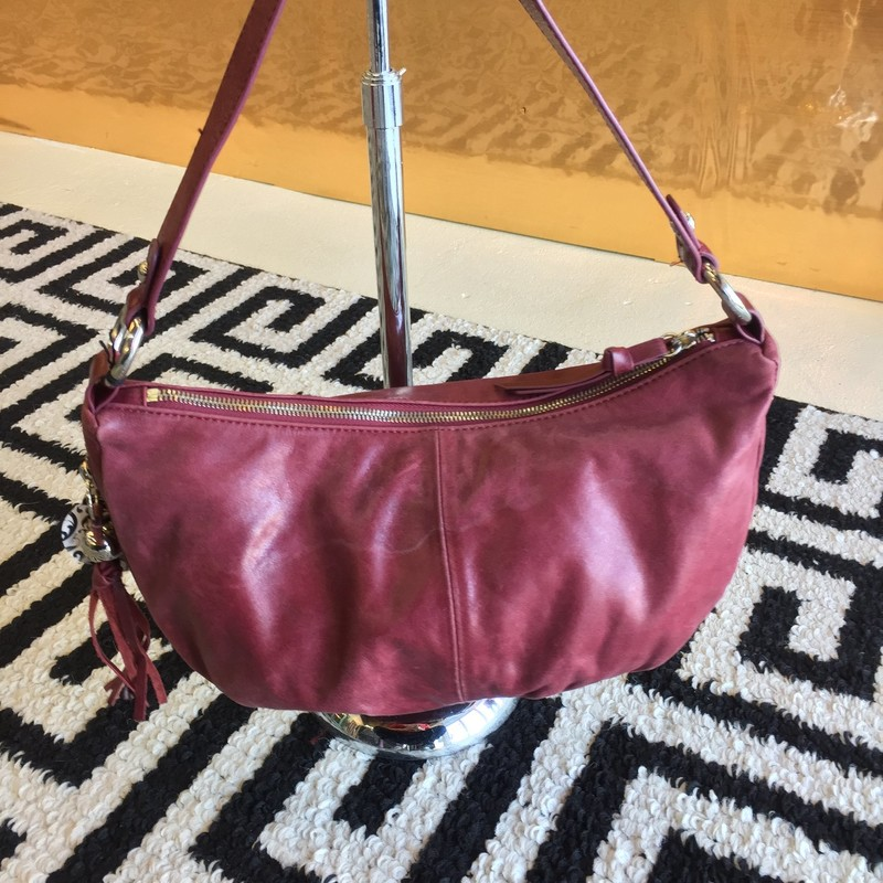GENTLY USED, Hobo brand, maroon leather purse with silver hardware, with side zipper with tassel