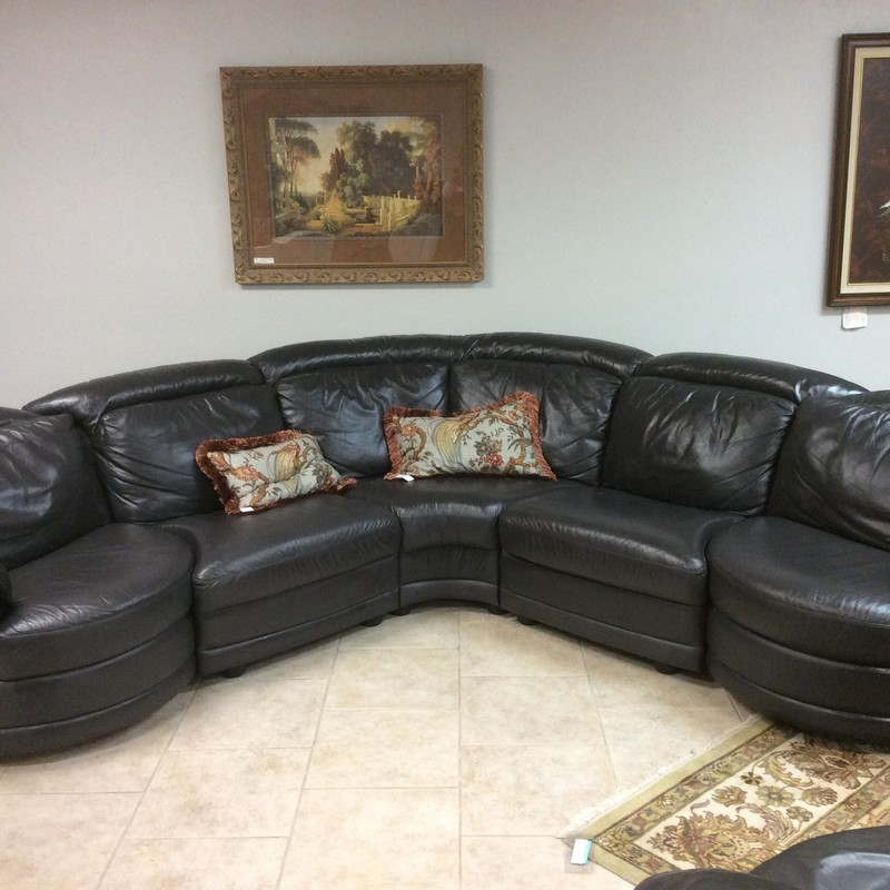This sleek little sectional is upholstered in a buttery soft graphite colored leather. Each of the end units actually swivel 1/2 way, whereby allowing one to EASILY reposition their body's direction.There is also a matching stand alone swivel chair that is available for purchase seperately.
