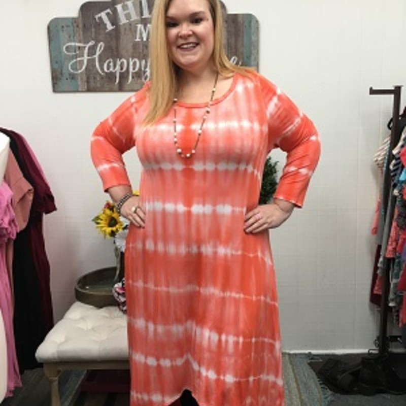 Tonya looks stunnning in our Tie Dye Hi Lo Dress! This would make the perfect cruise dress. Super comfy and easy to wear. The material is made of 97% Rayon 3% Spandex with a length in the front of 44in and the back 56in, and it has pockets!!