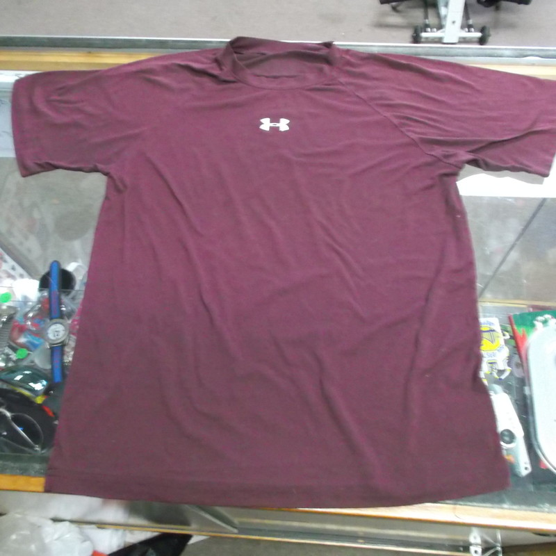 Under Armour YOUTH Loose Fit Short Sleeve Shirt Size Medium  Maroon #8452<br /> Rating:   (see below) 4 - Fair Condition <br /> Team: n/a<br /> Player: n/a <br /> Brand: Under Armour<br /> Size: Medium - YOUTH(Measured Flat: Across chest 17&quot;; Length 23&quot;) top of shoulder to the hem<br /> Color: Maroon<br /> Style: Short sleeve loose fit shirt<br /> Material: 95 Polyester 5 Elastane<br /> Condition: - Fair Condition - wrinkled; Material is faded and discolored; Significant pilling and fuzz; Material feels coarse; Shows definite signs of use(Please see the photos for condition and description) <br /> Shipping cost: $3.37 <br /> Item #: 8452-70